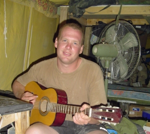 Jason Moon_Playing guitar in Iraq